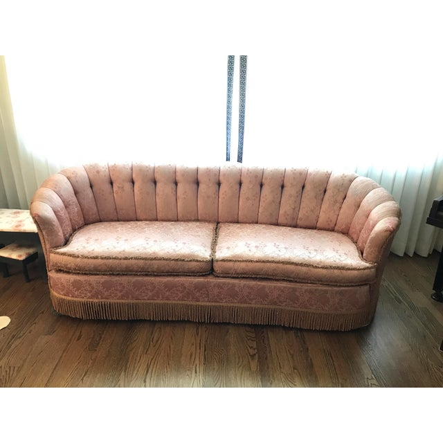 Amazing pink sofa with fringe bottom. The fabric on the cushions and back are in fabulous shape. And the bounce and shape...