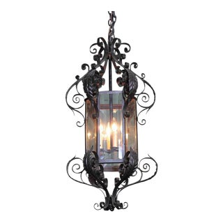 Tall Early 20th Century French Black Four-Light Iron Lantern With Beveled Glass For Sale