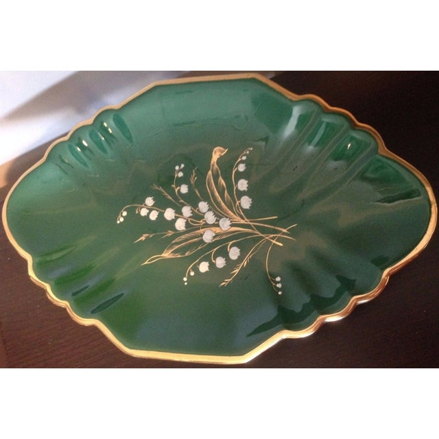 Emerald Green Maioliche (Majolica ) footed platter. Hand painted lily of the valley white flowers with gold stems and...