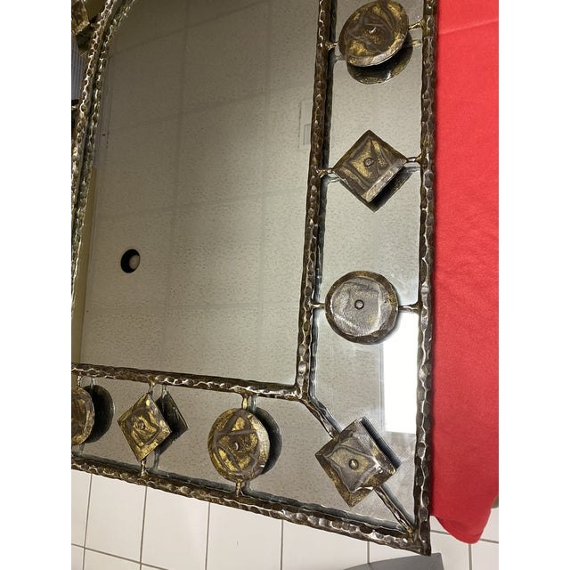 A gorgeous rustic hammered iron mirror from Holly Hunt, original Holly Hunt merchandise mart tag still attached. Rounded...