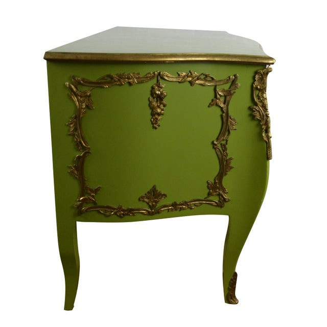 Louis XV style green color, gold color trim with brass ormolu two-drawer commode. A fun pop of color for your living space!