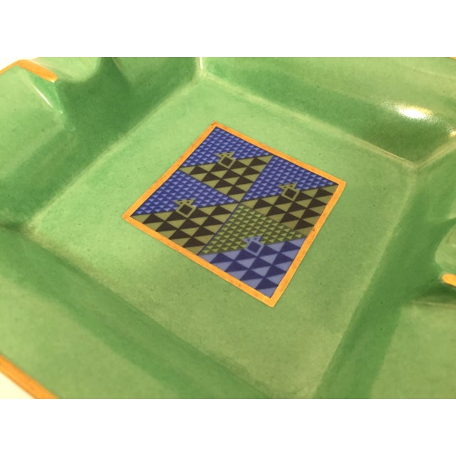 Modern porcelain square green and gold ashtray with a modernist abstract blue design in the middle. Use it as an ashtray,...