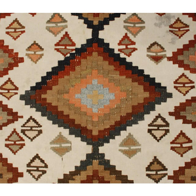 An early 20th century Persian Ersin Kilim runner with a wonderful all-over diamond pattern on a cream background,...