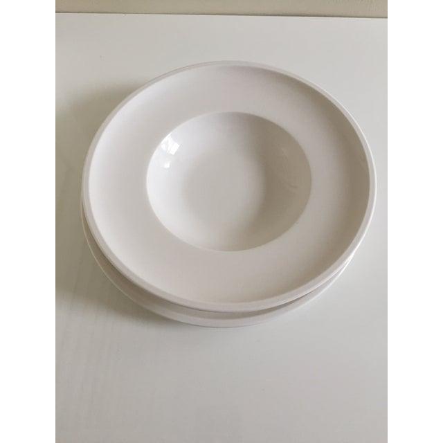 2 white porcelain round plates 1 flat plate: Diam.:10 1/2 Inches 1 deep plate: Diam.: 9 3/4 Inches, rim: 2 1/4 Inches...