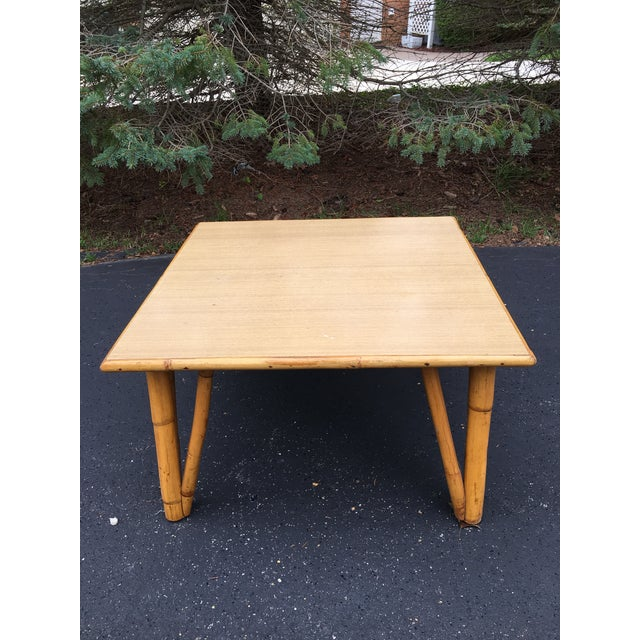 "Up for your consideration is this 1940's square rattan coffee table measuring 28 1/2"" x 28 1/2"" x 17"" tall. Laminate top...."