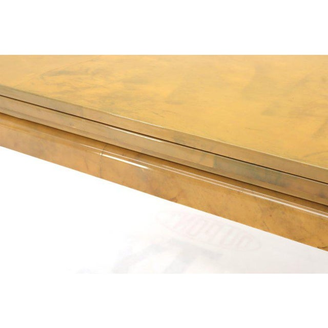 Mid-Century Modern lacquered parchment square convertible expandable dining table. High quality thick lacquer finish over...