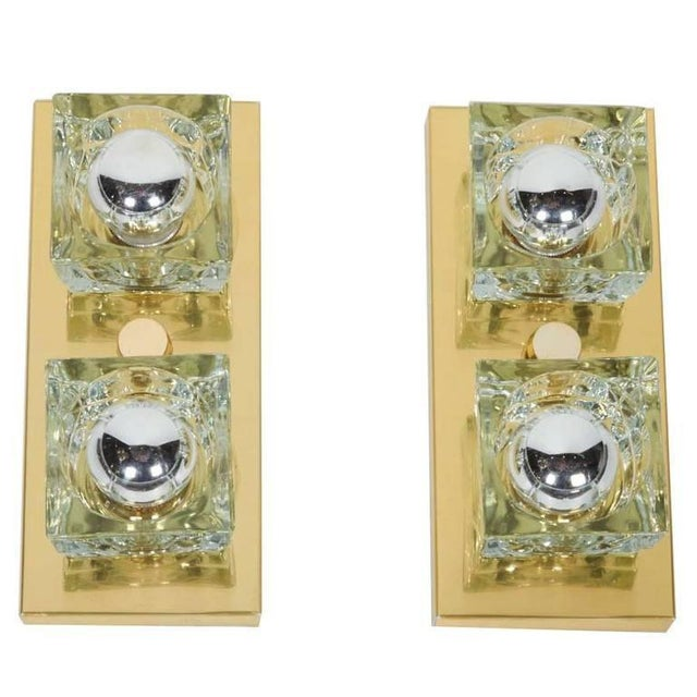 Cubist Mid-Century Modern wall sconces featuring two handcut glass shades each in block forms. Frames are wall-mounted...