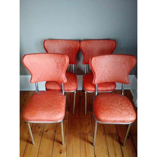 Authentic set of 4 retro chrome & orange vinyl 1950s kitchenette chairs. One chair has: B. Brody Seating Co. 1950s Dining...
