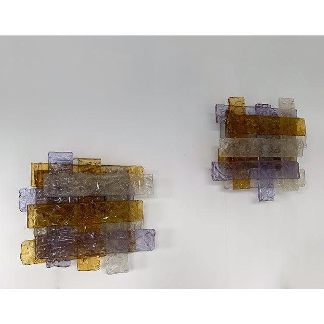 Rare model of braided purple, amber and clear Murano glass wall lights sconces by the manufacture Venini design attributed...