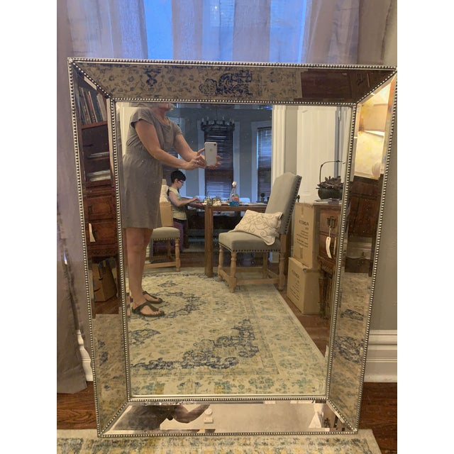 Large beveled glass mirror with silver leaf and silver ribbing detail. Restoration hardware Mirror features broad beveled...