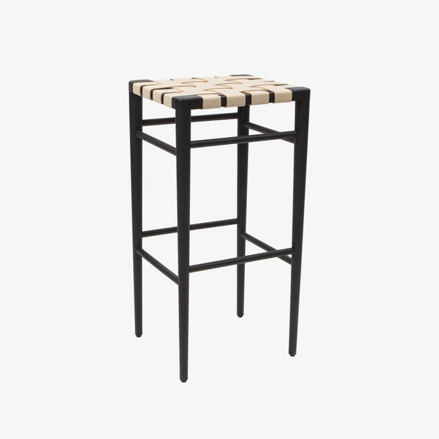 Smilow Furniture solid walnut bar stool with ebonized finish and white leather webbing. Also available in black, chocolate...