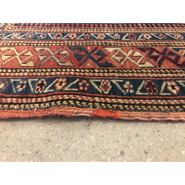 One-of-a-kind, antique wool Caucasian rug, circa 1880.Handmade. The ivory field of this antique Kuba rug is covered with a...