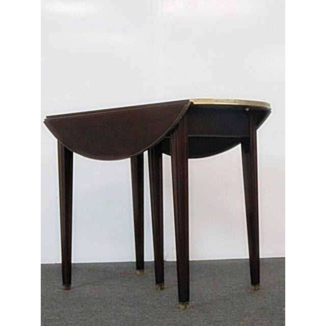 """Directoire style drop leaf dining room table with brass accents, center support leg, and 4 - 13.5""""leaves. This is 33""""d..."""