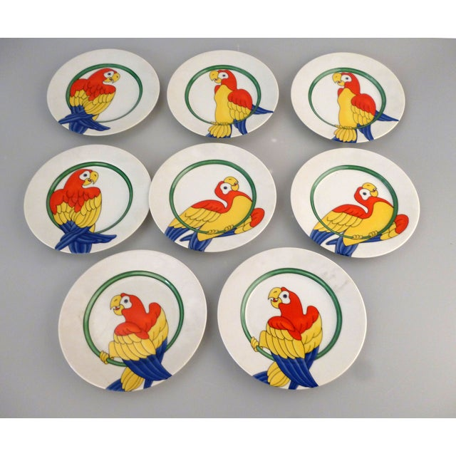 "Set of 8 Fritz and Floyd ""Parrot in Ring"" Plates. Makers Mark and Date underneath each plate."