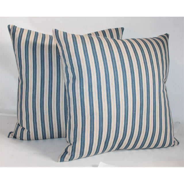 Vintage striped ticking pillows. These ticking pillows are in great condition with vintage linen backing. Down and feather...