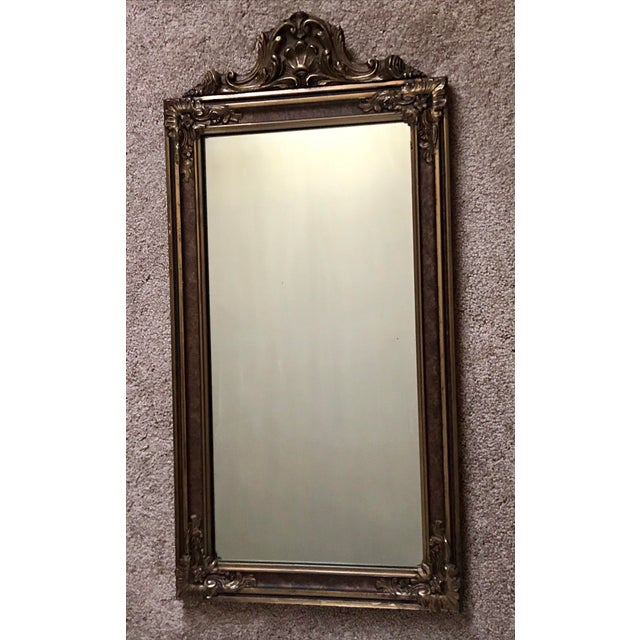 Beautiful Antique Wood hand carved mirror. Ornate details with a slight gold under tone. Frame has a few light surface...