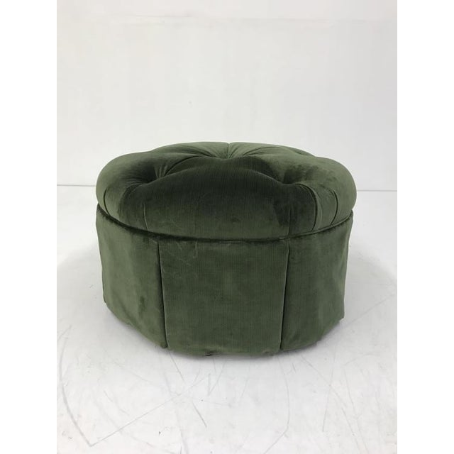 The Cheryl Skirted Ottoman is a first quality showroom sample that features a green fabric with an empire skirt and casters.