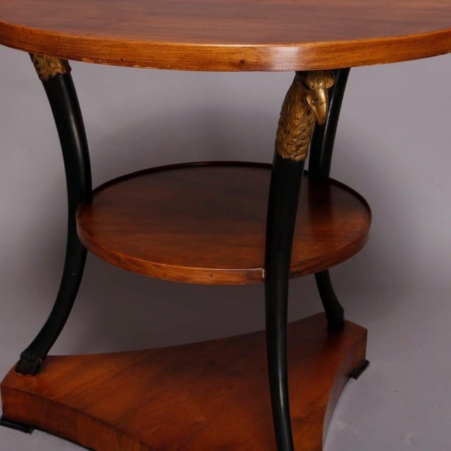 A vintage French Empire figural lamp stand offers mahogany construction with round top surmounting lower round display...