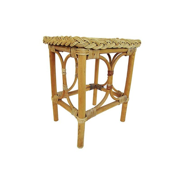 1930s English bamboo side table with a woven rattan top. Minor wear.