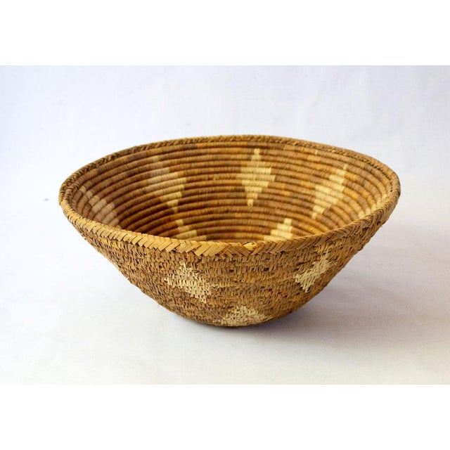 Luxurious mid-century hand woven basket with diamond motif. A beautiful neutral accent for holding scarves and gloves,...