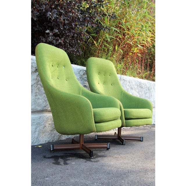 A striking and comfortable pair of High Back Swivel Lounge Chairs by Viko Baumritter. Done in original lime green tweed,...