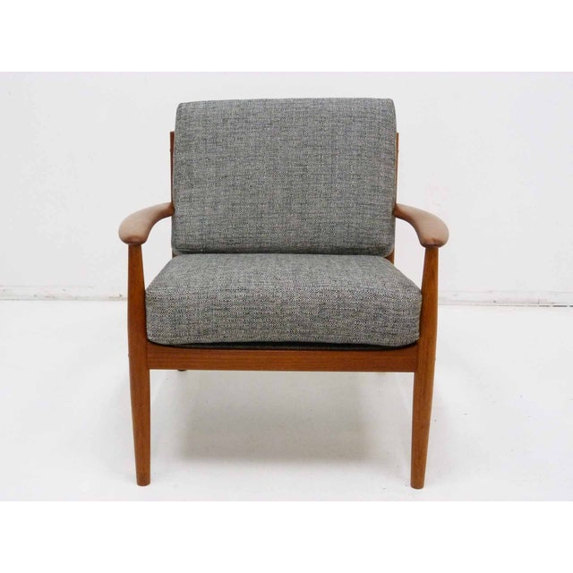 Classic Danish Modern solid teak lounge chair by Grete Jalk for France & Son, Denmark. Newly upholstered with new foam and...