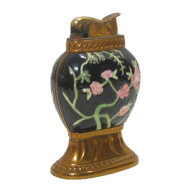 Beautiful midcentury black enamel lighter with lovely pink dogwood motif in an Asian / Chinoiserie style. Copper toned...