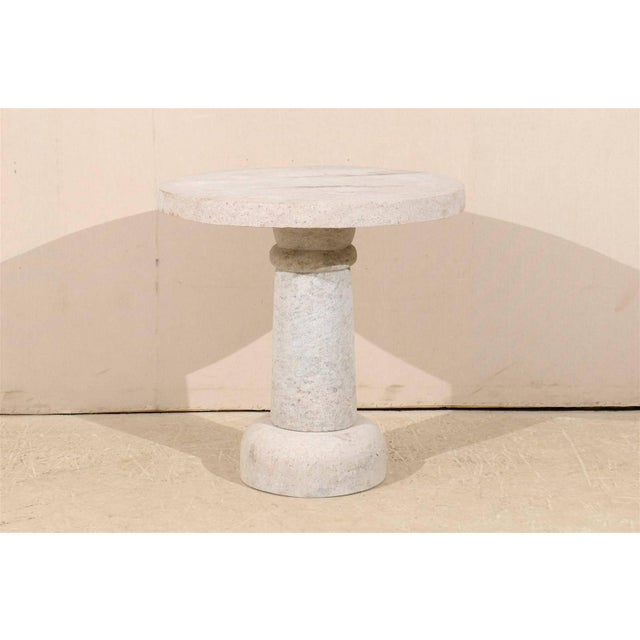 A round hand-carved granite contemporary pedestal table. This round granite table would be perfect for indoor or outdoor...