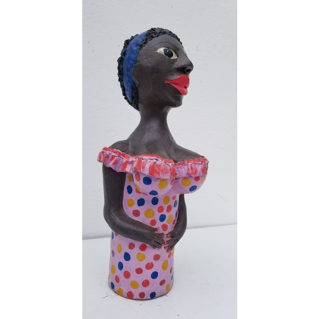 Offered for sale: this fantastic Brazilian handmade and painted colorful female sculpture. Made of compressed cardboard...