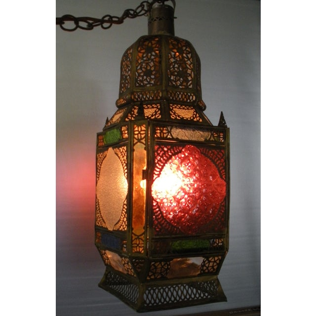 Large Moroccan pierced brass hanging lantern. Traditionally handmade to be used with a wax candle, this lantern has...
