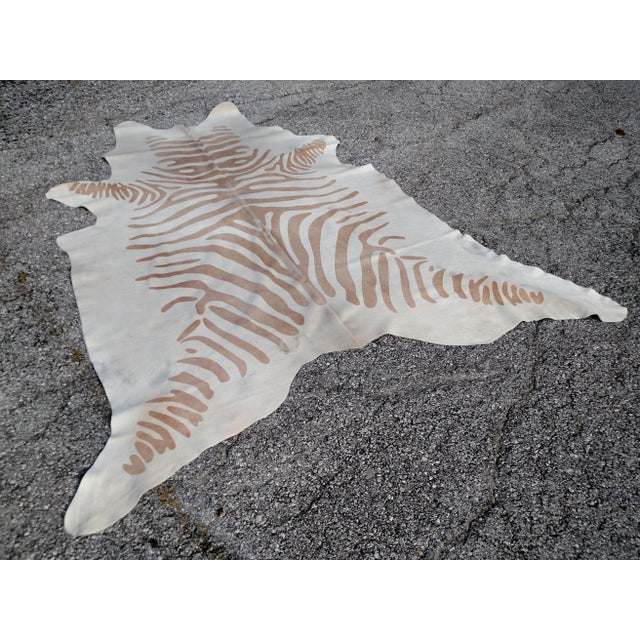 Brand New tan zebra print cowhide rug. Easy to maintain for many years. Soft and durable. You can spot clean with mild...