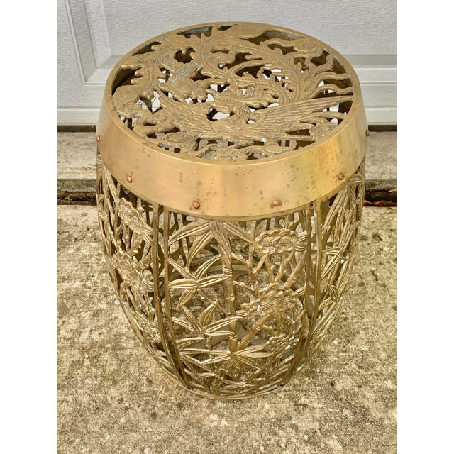 Stunning vintage garden stool. Made of solid brass. Features a bamboo and flower design on the sides. With a bird on the...