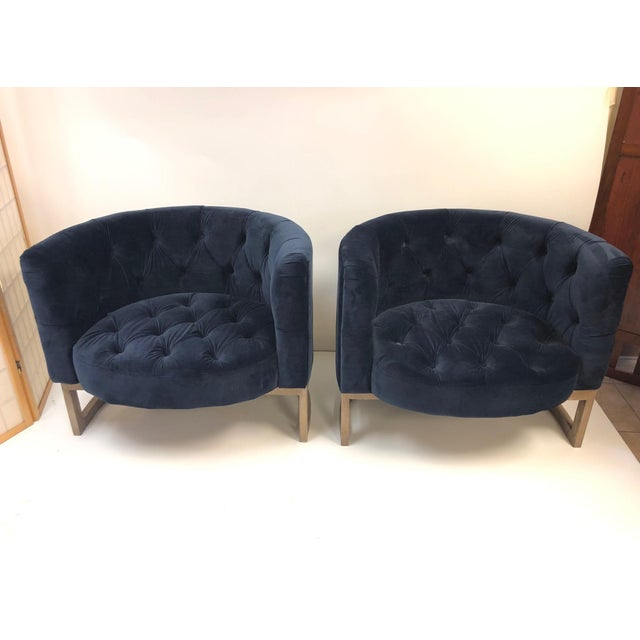 Pair of modern cerused oak lounge chairs style of Milo Baughman. Chairs are blue velvet with a loose back pillow.