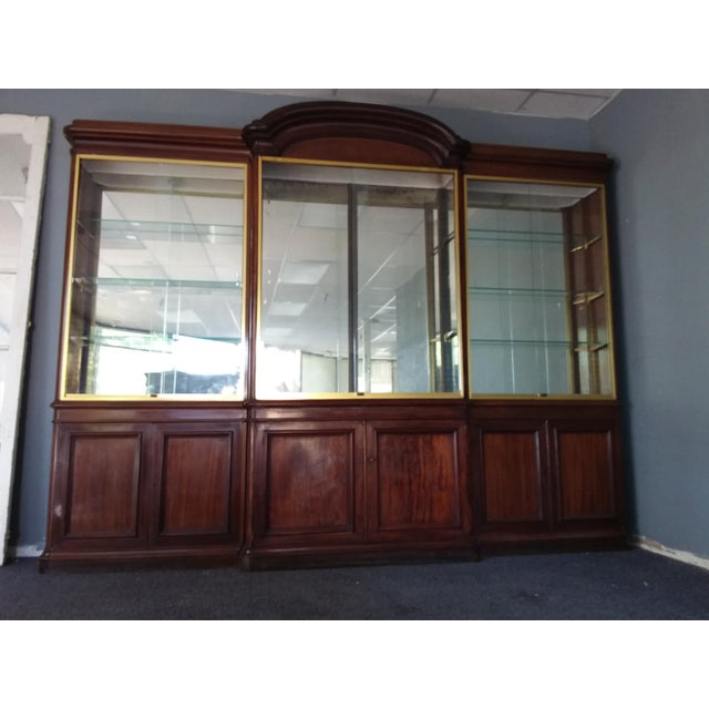 """This is a three piece cabinet, the two end sections are 10"""" deep and 92"""" high and the center section is 14"""" deep and 98""""..."""