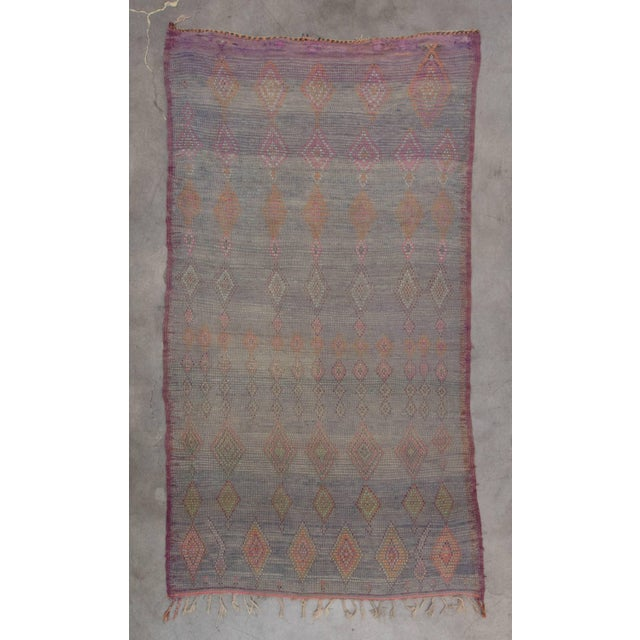 The Beni M'Guild tribe yields from the middle atlas region of Morocco. Their rugs tend to be very plush, woven to provide...