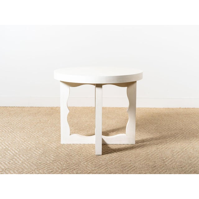 Round table with sculptural cutout base Constructed of solid Ash wood Sancerre finish