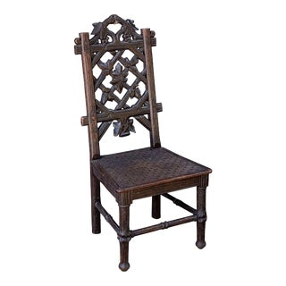 Black Forest Chair of Carved Oak from the 19th Century For Sale