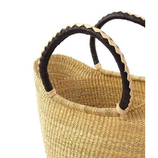 Artisans in the Bolgatanga region of Ghana weave these beautiful and durable baskets from thick, tough elephant grass. A...