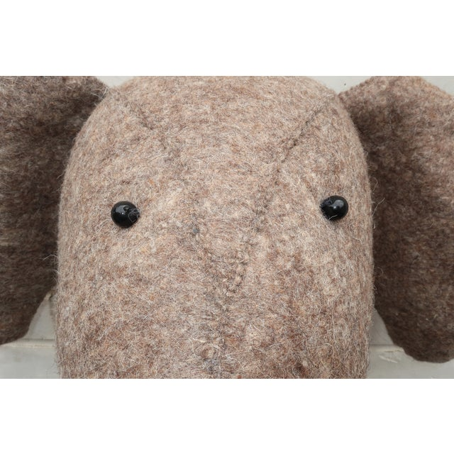 Pachyderm perfection! This wonderfully charming wool felt elephant head is designed to hang on the wall lending an exotic...
