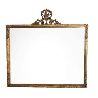 Horizontal French Provincial Giltwood Mirror With Shell Ribbon Motif Crest and Floral Design For Sale