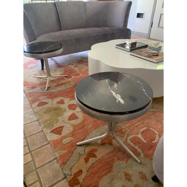 Sleek and very chic, a pair of side tables uniquely fabricated allowing three legs combined to house a sturdy aluminum...