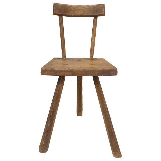 A wonderful pair of 3-legged Primitive chairs in carved solid oak. Great subtle detail with faceted legs and through...