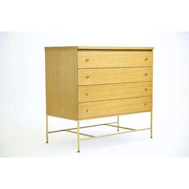 Four drawers, brass pulls and brass base