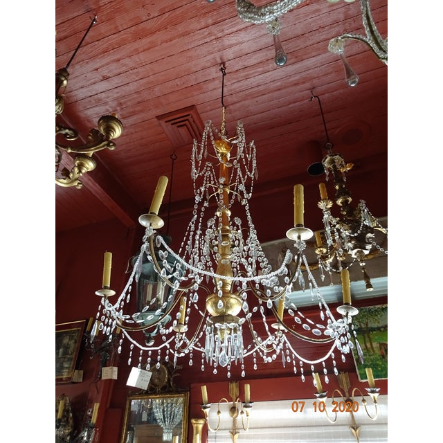 Fabulous large 19th century crystal chandelier from Lucca, Italy. Gilt wood carved stem. 6 lights. US wired. Crystal swags...