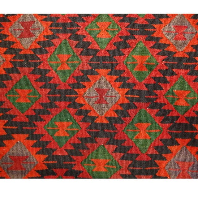 An early 20th century, century 1930s, Qazvin Kilim runner with all-over brilliant crimson, emerald and orange geometric...