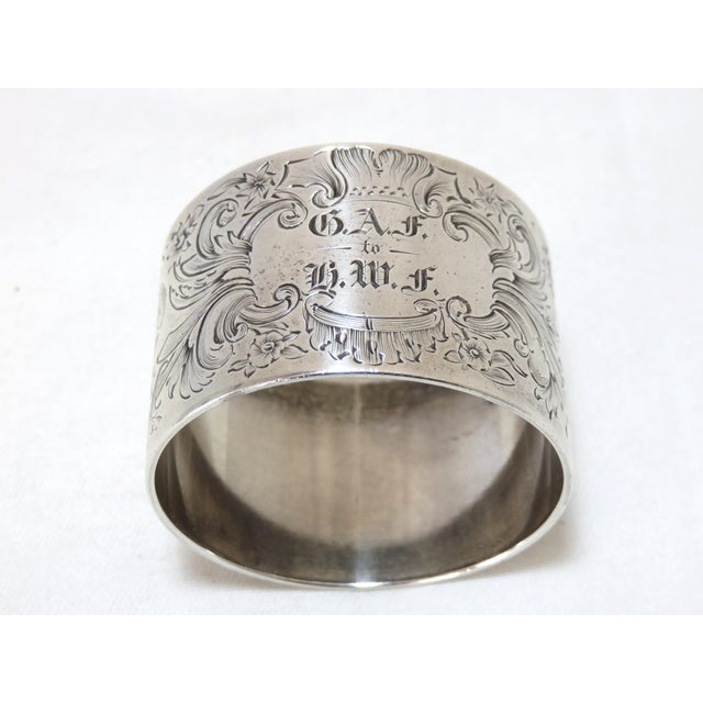 A Fine Quality Antique Oversize Sterling Silver Napkin Ring. Fancy Hand Engraved Features. American Made - Circa 1880S....