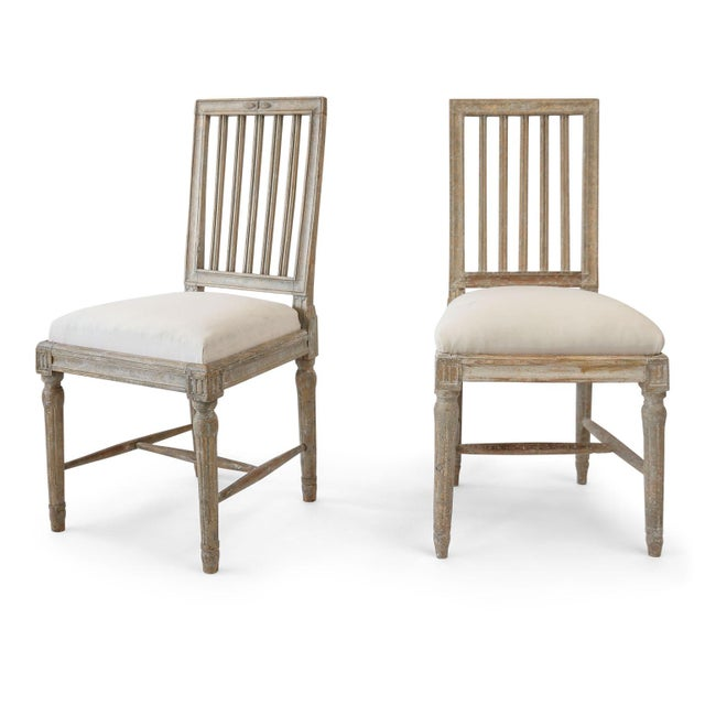 Six Gustavian dining chairs, painted gray-green (circa 1790-1810). Hand-carved Swedish neoclassical frames featuring slate...