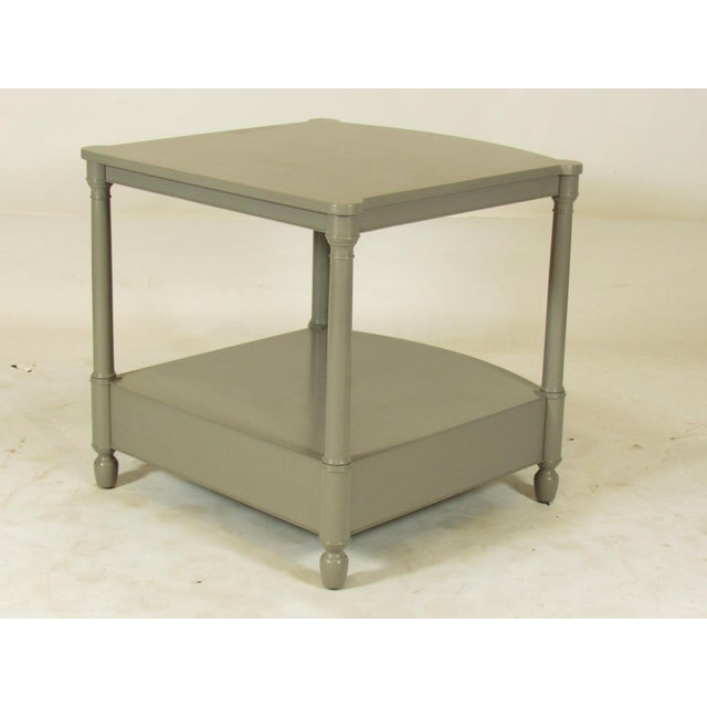 A pair of Mid-Century lacquer end tables by Baker with original gray lacquer finish, a lower drawer, a single dovetailed...