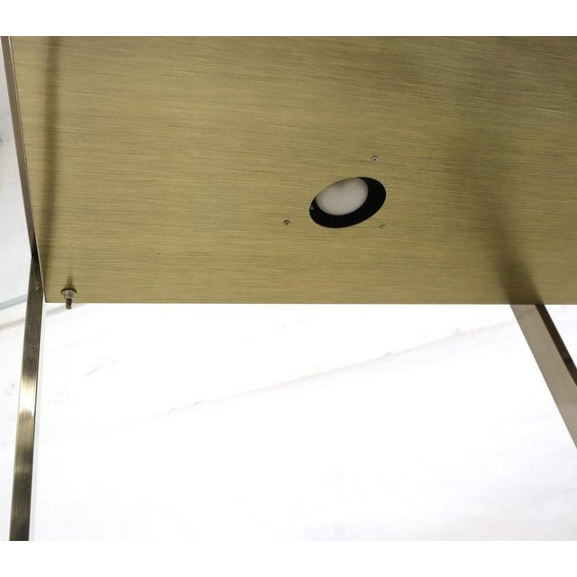 Mid century modern lighted étagère possibly designed by Mastercraft (unmarked). High quality craftsmanship metal...