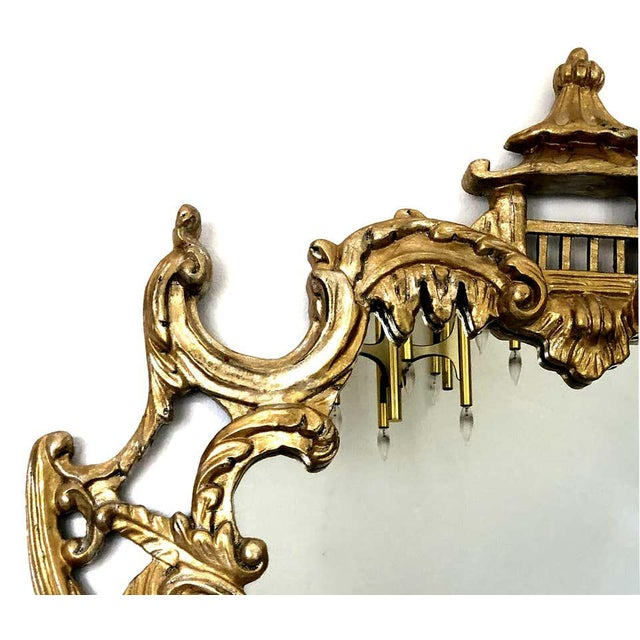 Offered for sale is an overscale Hollywood Regency giltwood pagoda chinoiserie mirror by Gampel-Stoll. The mirror is circa...